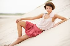 Attractive Young Woman Standing Amongst Sandunes Royalty Free Stock Images