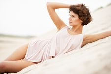 Free Young Woman Laying Amongst Sand Dunes Royalty Free Stock Photo - 14460995