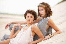 Free Two Young Women Laying Amongst Sandunes Royalty Free Stock Image - 14461096