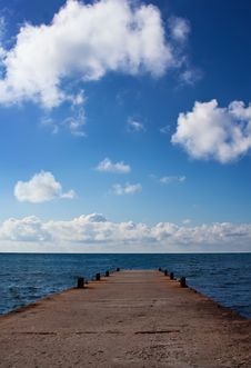Blue Sea With Clouds And Pier Royalty Free Stock Photo