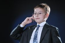Boy In Suit On Cellphone Stock Image