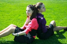 Young Businesswomen Relaxing On The Grass Stock Photo