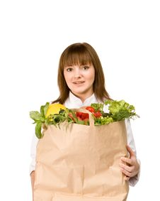 Free Cook Girl Holding A Paper Bag With Vegetables Stock Photos - 14464153