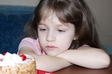 The Child Looks At A Pie Royalty Free Stock Photo