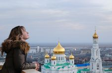 Girl And Religion. Cathedral. Rostov-on-Don. Royalty Free Stock Photos