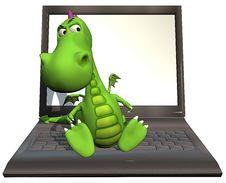 Free Baby Dragon Green On Laptop Stock Photos - 14465863