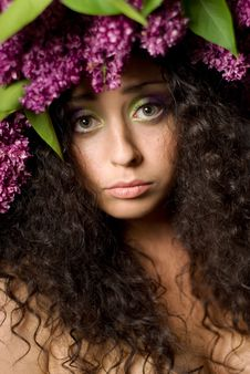 Girl In Lilac Garland Royalty Free Stock Photo