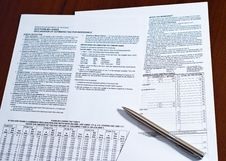 Free Tax Form With Pen On A Desk. Stock Photography - 14470022