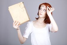 Red-haired Businesswoman Keep Book In Hand. Royalty Free Stock Photos