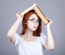 Free Red-haired Businesswoman Keep Books In Hand. Royalty Free Stock Image - 14470466