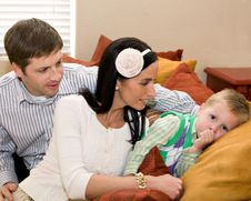 Father And Mother Looking Tenderly At Young Son Stock Photography