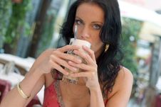Young Woman With Latte Macchiato Stock Photos