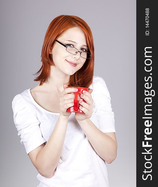 Red-haired businesswoman  keep red cup in hand