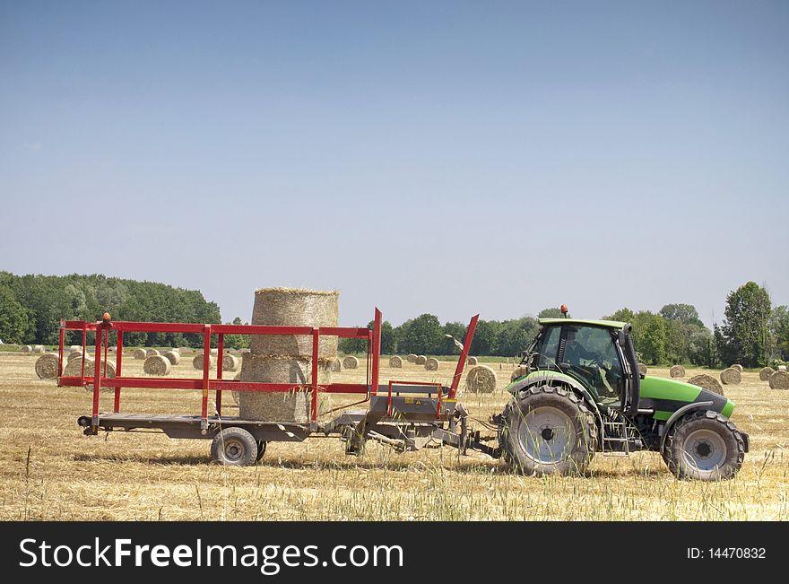 Tractor on hay balls