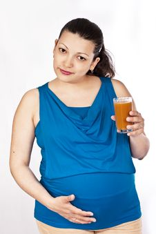 Pregnant Girl Holds Glass Of Apricot Juice Royalty Free Stock Photos
