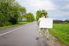 Free Tourist On A Country Road Royalty Free Stock Images - 14481659