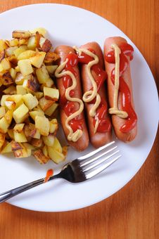 Free Sausage And Fried Potatoes Royalty Free Stock Image - 14482116
