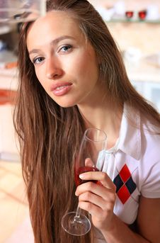 Beautiful Woman In Kitchen With Glass Royalty Free Stock Image