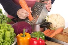 Free Cutting Carrot With Stainless Grater Stock Photography - 14485142