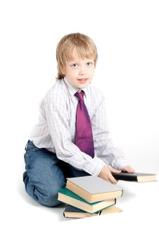 Free Young Boy With Books Stock Photos - 14485163