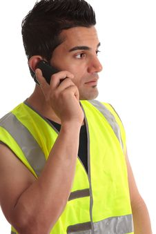 Free Tradesman On Phone Looking Sideways Royalty Free Stock Image - 14487476