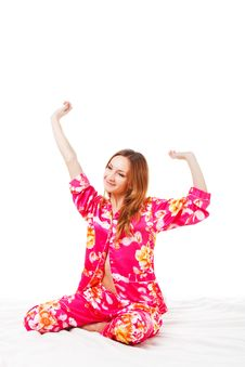 Free Sweet Young Girl In Pink Pajamas On Bed Royalty Free Stock Photography - 14488207