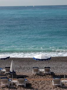 Sun Loungers On The Beach At Nice Stock Images