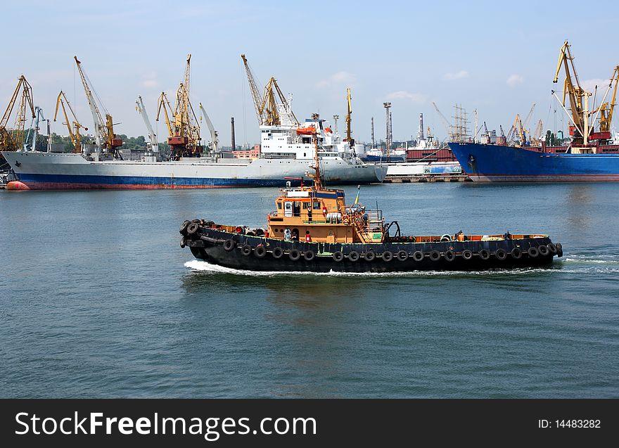 Moving tugboat