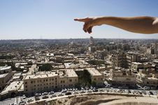 Man Pointing To The Infinite Over Aleppo, Syria Royalty Free Stock Images