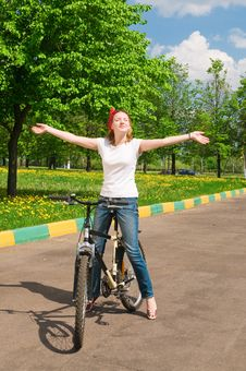 Free Shoot Of Young Woman With Bicycle Royalty Free Stock Photography - 14493667