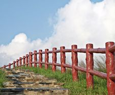 Free Red Fences Leading The Path Under Beautiful Blue S Royalty Free Stock Photos - 14493768