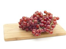 Bunch Red Grapes On Board Stock Photo