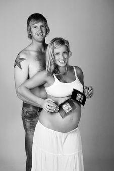 Young Pregnant Couple Holding Ultrasound Photos Royalty Free Stock Photos