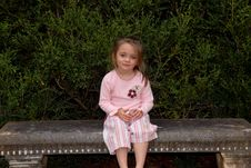 Free Little Girl Sitting On Garden Bench Royalty Free Stock Image - 1454496
