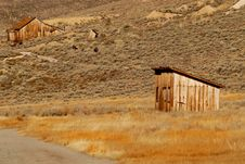 Free Two Deserted Wooden Structures In Old Mining Town Royalty Free Stock Photography - 1455037