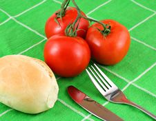 Red Tomatoes On Green Cloth Stock Photos
