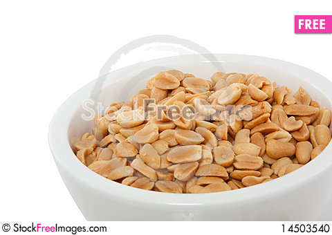 A white cup with peeled peanuts Stock Photo