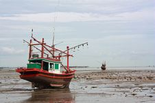 Free Fishing Boat Stuck On Shore Stock Photo - 14500780
