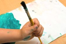 Free A Kid S Hand With Paintbrush Royalty Free Stock Photography - 14501467