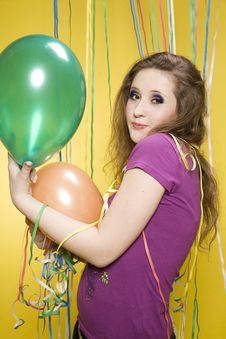 Girl With Balloons And Paper Streamer Stock Photos
