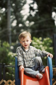 Free Cute Child On Slide Stock Photography - 14503082