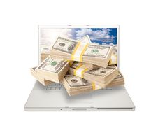 Laptop With Stacks Of Money Coming From Screen Royalty Free Stock Photography