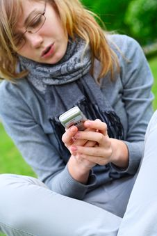 The Girl With Phone In Hands Stock Photography