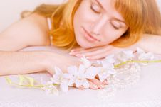 Free Red-haired Girl And Orchid Royalty Free Stock Photos - 14507088