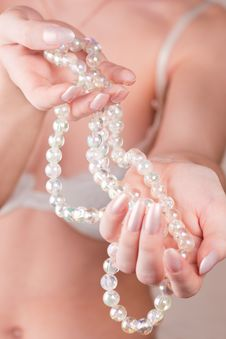 Free Girl Holding Beads Stock Images - 14507104