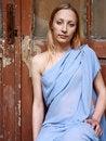 Free Beautiful Blonde In Blue Tunic Near Door Royalty Free Stock Photos - 14518048
