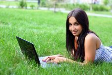 Free Young Woman With Laptop Lying Jn The Green Grass Stock Image - 14510561