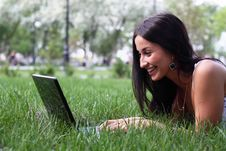 Free Young Woman With Laptop Lying Jn The Green Grass Stock Photography - 14510562
