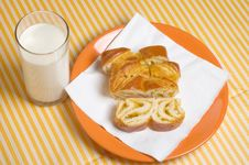 Milk And Pieces Of Sweet Pie Stock Image