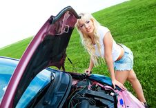 Girl Repairing Car Stock Photography